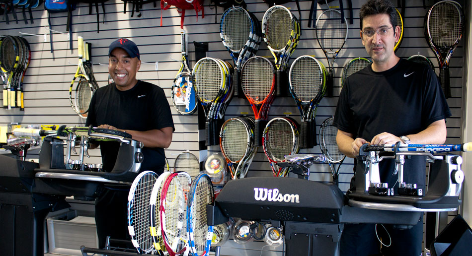 Stringing racquets at our local Doral store